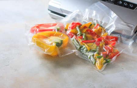 Vegetables in sealed vacuum packing bags. Su-video cooking. Selective focus