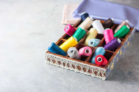 Bright multi colored embroidery thread yarns. Handmade embroidery sewing background. Selective focus