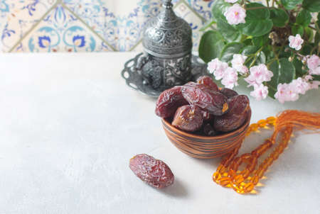 Dates fruit and rosary still life. Selective focus