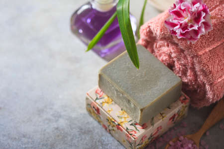 The concept spa. Handmade soap, towels, flowers and sea salt. Selective focus