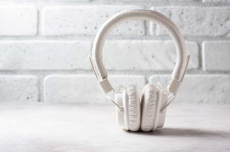 White headphones on white background. Macro