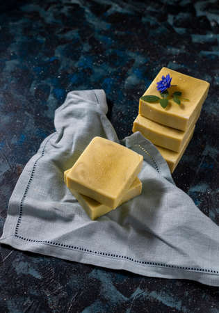 Organic cosmetics. Eco handmade soap, spa products in a wooden box. No plastic, green life and zero waste concept. Japanese Furoshiki style. opy space Foto de archivo - 135444318