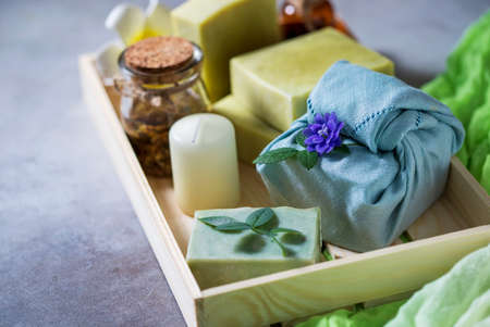 Organic cosmetics. Eco handmade soap, spa products in a wooden box. No plastic, green life and zero waste concept. Japanese Furoshiki style. opy space Foto de archivo - 135444321