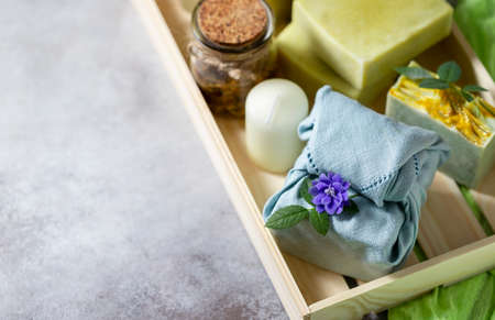Organic cosmetics. Eco handmade soap, spa products in a wooden box. No plastic, green life and zero waste concept. Japanese Furoshiki style. opy space Foto de archivo - 135444340