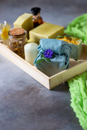 Organic cosmetics. Eco handmade soap, spa products in a wooden box. No plastic, green life and zero waste concept. Japanese Furoshiki style. opy space Foto de archivo - 135444346
