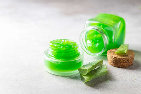Fresh aloe vera gel in a glass jar with aloe on a light background. Selective focus,copy space for text. Stock Photo