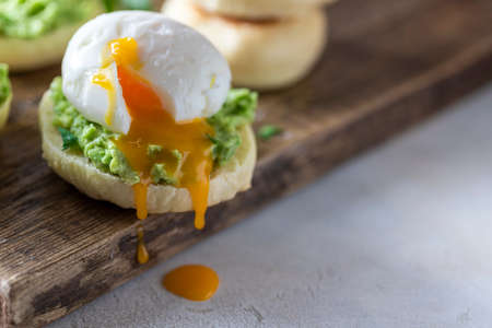 Fresh Homemade English Muffins with Avocado and Egg. Breakfast, morning concept. Selective focus, copy space