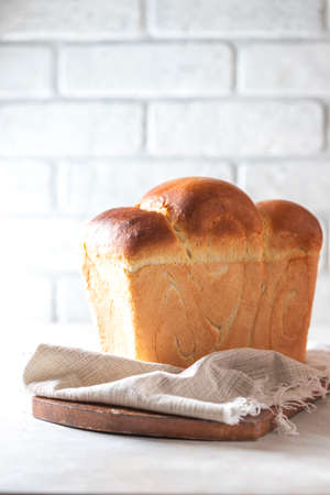 Japanese brioche, Japanese milk bread. Homemade baking. Fresh homemade crisp bread. Copy space, selective focus