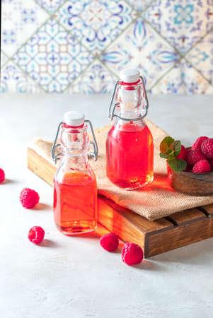 Homemade raspberry vinegar and fresh raspberries. Selective focus, copy space