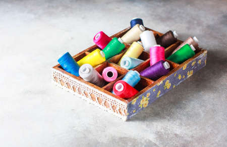 Bright multi colored embroidery thread yarns. Handmade embroidery sewing background.