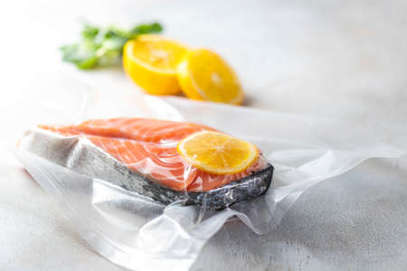 Salmon fillets in a vacuum package. Sous-vide, new technology cuisine. Selective focus, copy space 스톡 콘텐츠