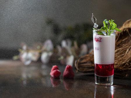Shot cocktails with raspberry, vanilla liqour, vodka. Fresh summer shots for party. Alcohol shots
