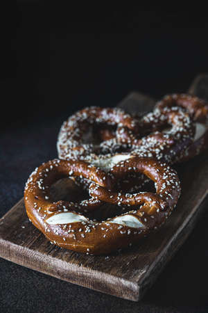 Pretzel on wooden table. Perfect for Octoberfest. Bavarian pretzels. Selective focus, copy space. Reklamní fotografie