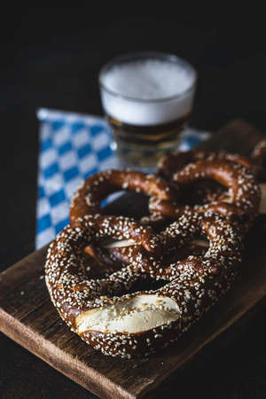 Pretzel on wooden table. Perfect for Octoberfest. Bavarian pretzels. Selective focus, copy space.