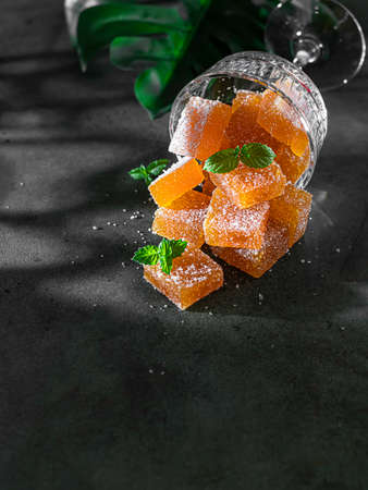 Homemade from mango and passionfruit jelly candies in sugar with mint. Homemade marmalade candy. Selective focus
