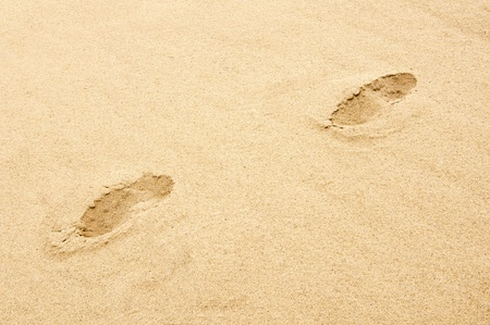 footmark: Footprints on the beach, the road of life metaphor, abstract expression.