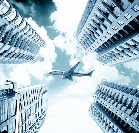 flew: Modern city of skyscrapers, a passenger plane flew across the sky.