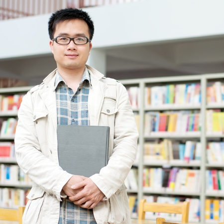 Pictures of handsome men in the library Stock Photo - 10757483