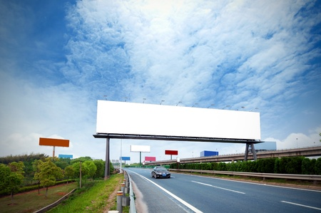 erected: Highway, next to the countless billboards erected.  Stock Photo