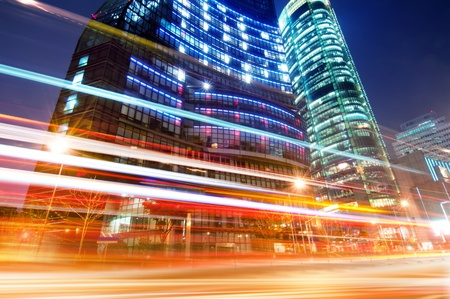 city lights: The light trails on the modern building background in shanghai china. Stock Photo