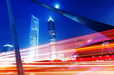The light trails on the modern building background in shanghai china. Stock Photo - 10828734