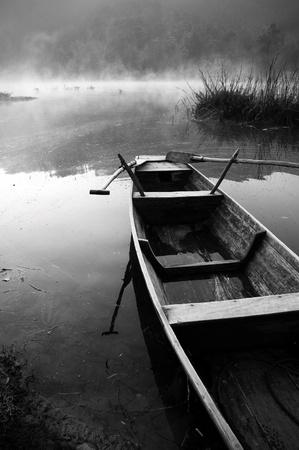 fisherman boat: Boat in the morning mist