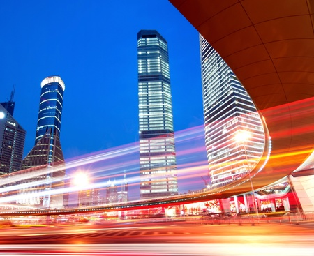 The light trails on the modern building background in shanghai china. Stock Photo - 10828957