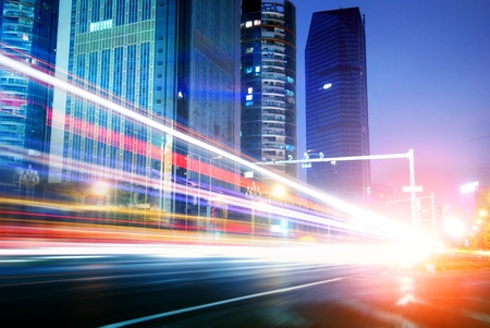 car lights: The light trails on the modern building background in shanghai china. Stock Photo