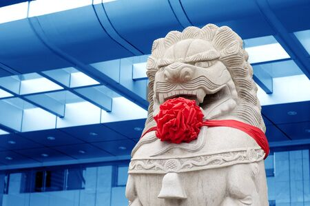 Traditional Chinese stone lions guard at the gate. Stock Photo - 10874249