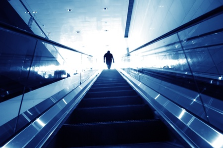 man on the escalator, modern inter. Stock Photo - 10874322