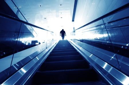 man on the escalator, modern interior. Stock Photo - 10874322