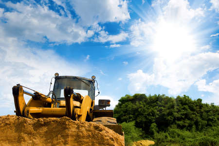 loess: A large yellow bulldozer at a construction site low angle view Stock Photo