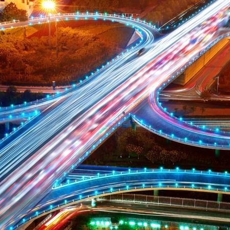 overpass: Overpass at night, heavy traffic.