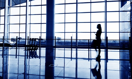 Passenger in the shanghai pudong airport.interior of the airport. Stock Photo - 12053233
