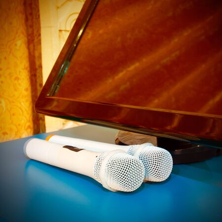announcer: On display next to a pair of microphones, a strong color contrast Stock Photo