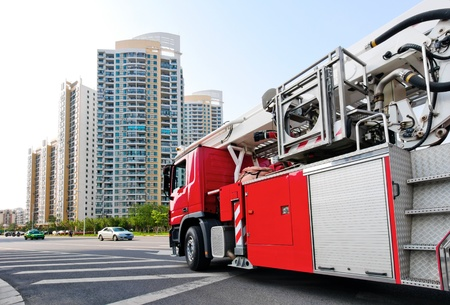 colourful fire: Red fire engine, is waiting for departure. Stock Photo