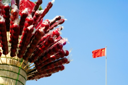 sugarcoated: Chinese national flag under the sugar-coated haws  Sugar-coated haws is Beijing