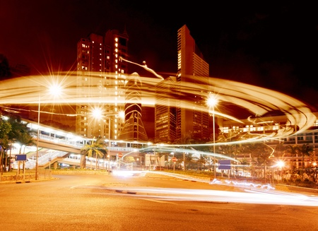 Highway light trails, modern city at night  photo