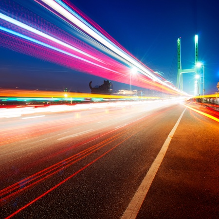 cars light trails on the modern bridge at dusk Stock Photo - 12674229