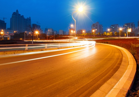 beautiful light trail at the busy highway photo