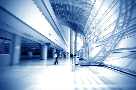 elevated walkway: Passengers in Shanghai Pudong Airport corridor