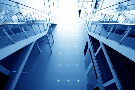 go inside: Hall stairs and escalators, modern building interior  Stock Photo