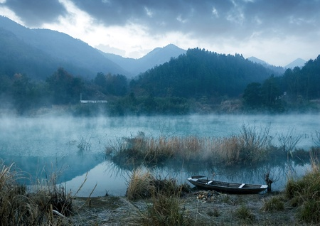 Winter morning, a mist on the lake Stock Photo - 13103295