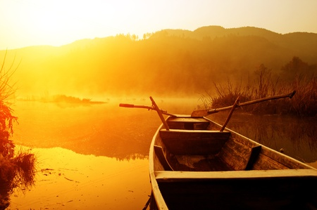 The morning of the lake, the boat docked in the lake. Stock Photo