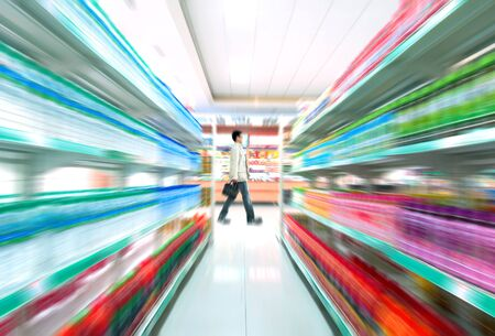 aisle: Man shopping in the supermarket