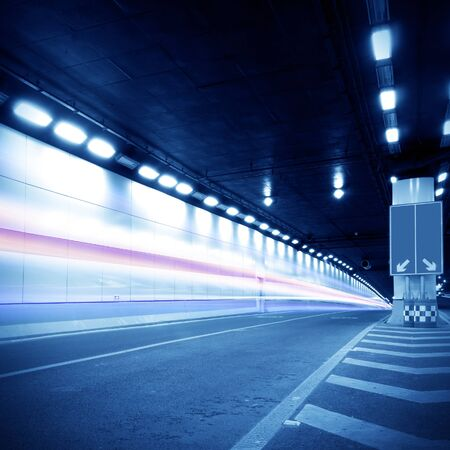 Abstract speed motion in urban highway road tunnel, blurred motion toward the central  Shot from a slow moving car Stock Photo - 13179226