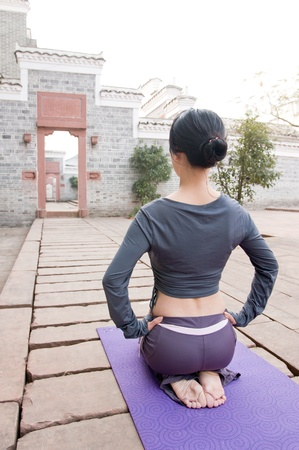 chinese young woman practicing yoga outdoors Stock Photo - 13307191