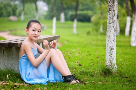 naivete: Girl sitting on the grass
