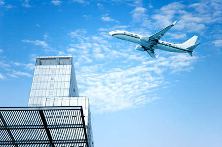 flew: High-rise next to a passenger plane flew across the sky.