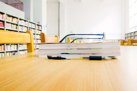 Library shelves, a large number of books. Stock Photo - 13412146